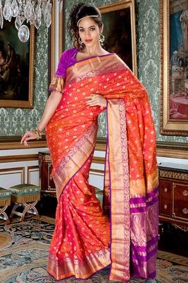 Peachish orange pure silk zari weaved saree in purple zari weaved pallu