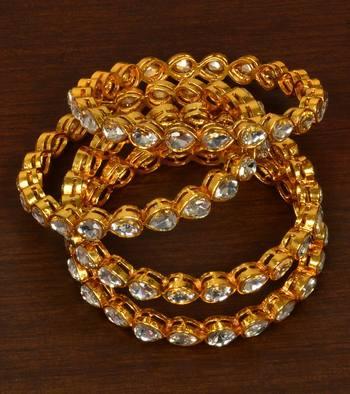 Gold plated kundan embellished bangles-and-bracelets