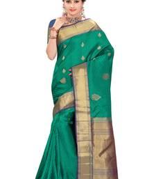 Peacock green plain pure silk saree with blouse