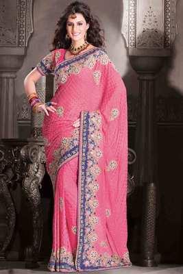 Pink georgette weaved & stone worked saree in blue velvet border