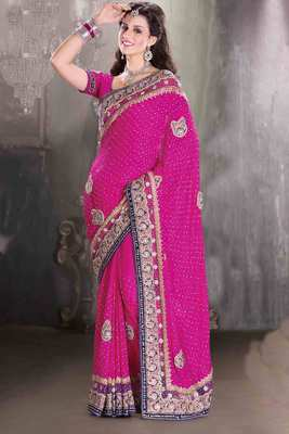 Rani pink georgette stone & zari worked saree in rani pink pallu