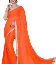 Buy Orange plain lycra saree with blouse below-400 online