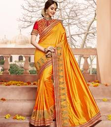 Buy Yellow embroidered silk saree with blouse wedding-saree online