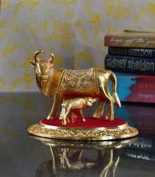 Golden Cow with Calf statue