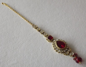 Red and Golden Traditional Maang Tikka studed with American Diamonds and Rubies