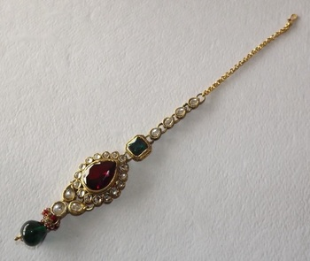Red and Golden Traditional Maang Tikka studed with American Diamonds and Emerald