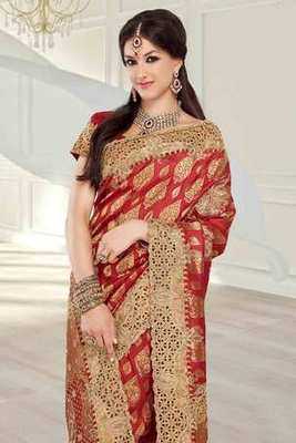 Red silk brocade zari & stone worked saree in red pallu & blouse