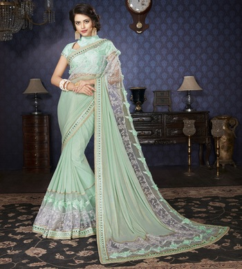 Green Embellished Lycra saree with blouse