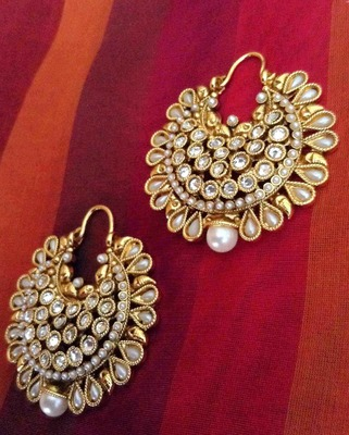 Pearl with polki base in a beautiful bali hoop Indian copper alloy earring