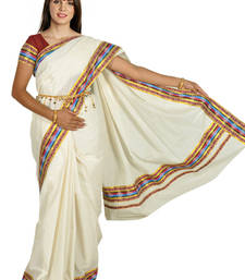 Buy cream colour sarees customised with brocade horizontal multicolour work border. kerala-saree online