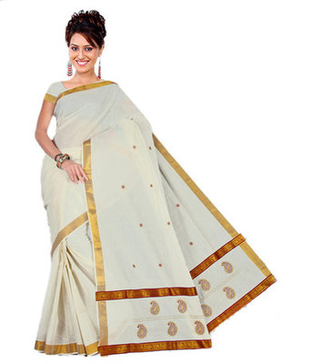 kasavu saree with golden border . Munthi enhanced with brocade laces.