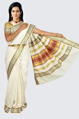 Fashionkiosks cotton cream weaved kerala kasavu saree with lace work and gold blouse