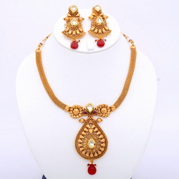 Desirable Polki Necklace Set With Maroon Drop