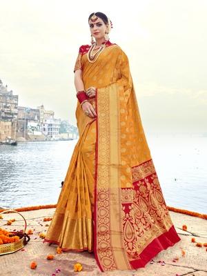 Gold woven banarasi art silk saree with blouse