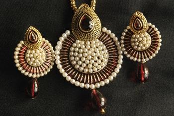 Beautiful Maroon Meena Pendant studded with Pearls
