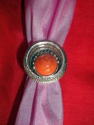 silver metal ring with orange stone studded