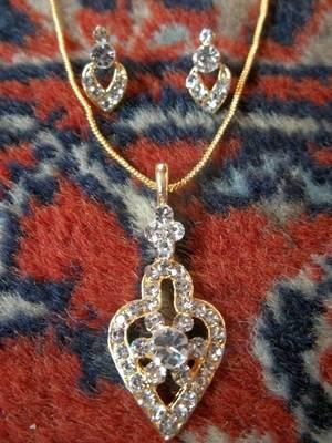 golden diamond pendant with matching earrings