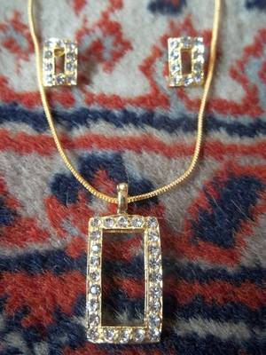 american daimond studded pendant with matching earrings
