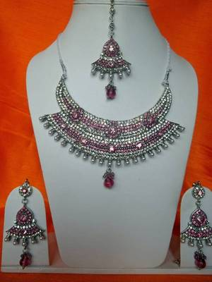 indian bridal pink stone and zircon studded necklace with matching earrings and maang teeka