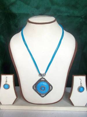turquoise pendant set with matching earrings