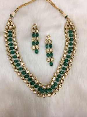 Bridal look emerald and polki necklace with matching earrings