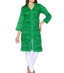 Dark green embroidered cotton stithced kurti