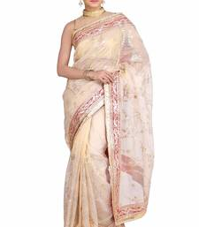 Golden embroidered pure tissue saree with blouse