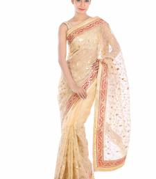 Beige embroidered pure tissue saree with blouse