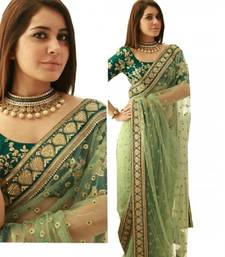 Buy Green embroidered net saree with blouse
