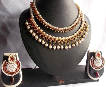 Buy two Maroon Pearl Polki Necklace Set