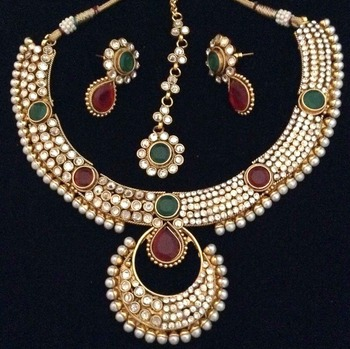 Dazzling polki with festive stonework India maroon green pearl necklace set