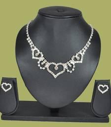 Buy  Sparkling Eternity Collection Signature Heartz Solitaire 4-piece American Diamond Jewellery Set vase online