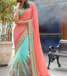 Dark peach embroidered net saree with blouse