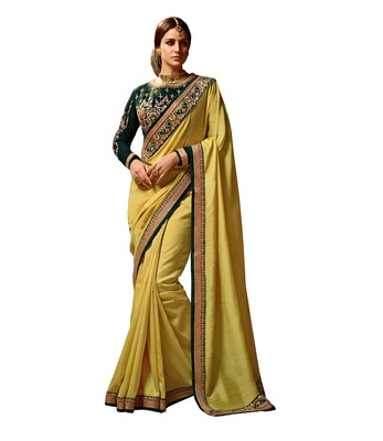 Yellow embroidered Magic Silk saree with blouse