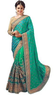 Green embroidered silk & net saree with blouse
