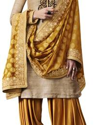 Beige coloured Raw Silk semi stitched ethnic suits