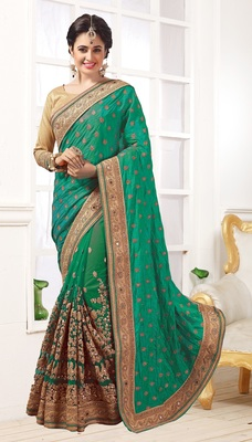 Green embroidered Georgette and Net  saree with blouse