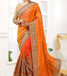Orange embroidered Georgette and Net  saree with blouse