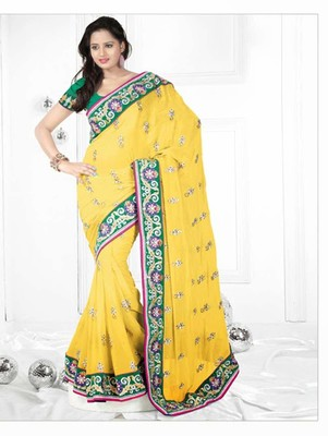 Light yellow embroidered georgette saree with blouse