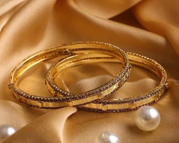 Pair Of Golden Bracelets With Golden Stonework For Dailywear