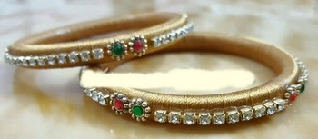 Beige bangles-and-bracelets