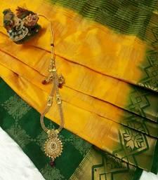 Buy Yellow Raw Silk Fancy Brocade kichha saree with unstitch Blouse brocade-saree online