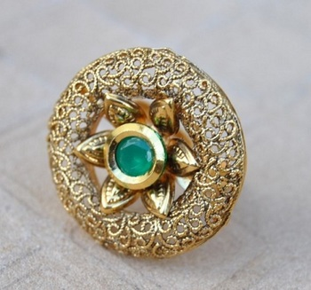 Intricately Designed Cocktail Finger Ring Studded with Emerald