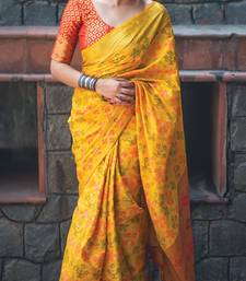 Yellow woven patola saree with blouse
