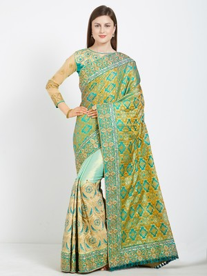 Green color silk jacquard and lycra saree with blouse