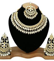 White kundan rose gold necklace sets