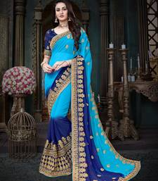 Buy Manohari Blue Embroidered Georgette Saree with Blouse  women-ethnic-wear online