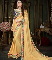 Buy Manohari Beige Embroidered Georgette Saree with Blouse  women-ethnic-wear online