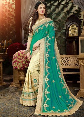 Teal embroidered art silk blend saree with blouse