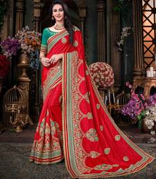 Red embroidered art silk blend saree with blouse